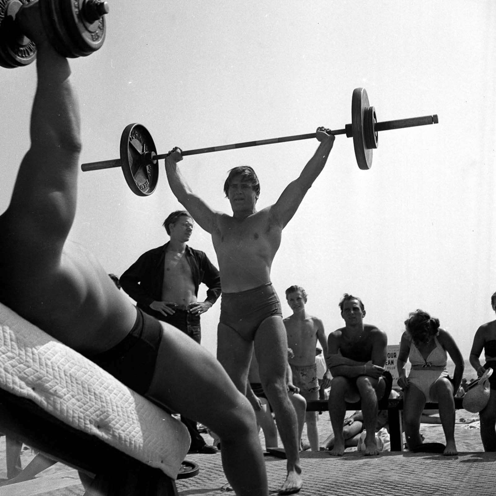 """A bodybuilder would have called the bodies at Muscle Beach in the '30's """"Functional Physiques."""" Lean and hard, but not with the kind of size that heavy weight training earns a man. Still, it was enough to make them stand out from the Average Joe."""
