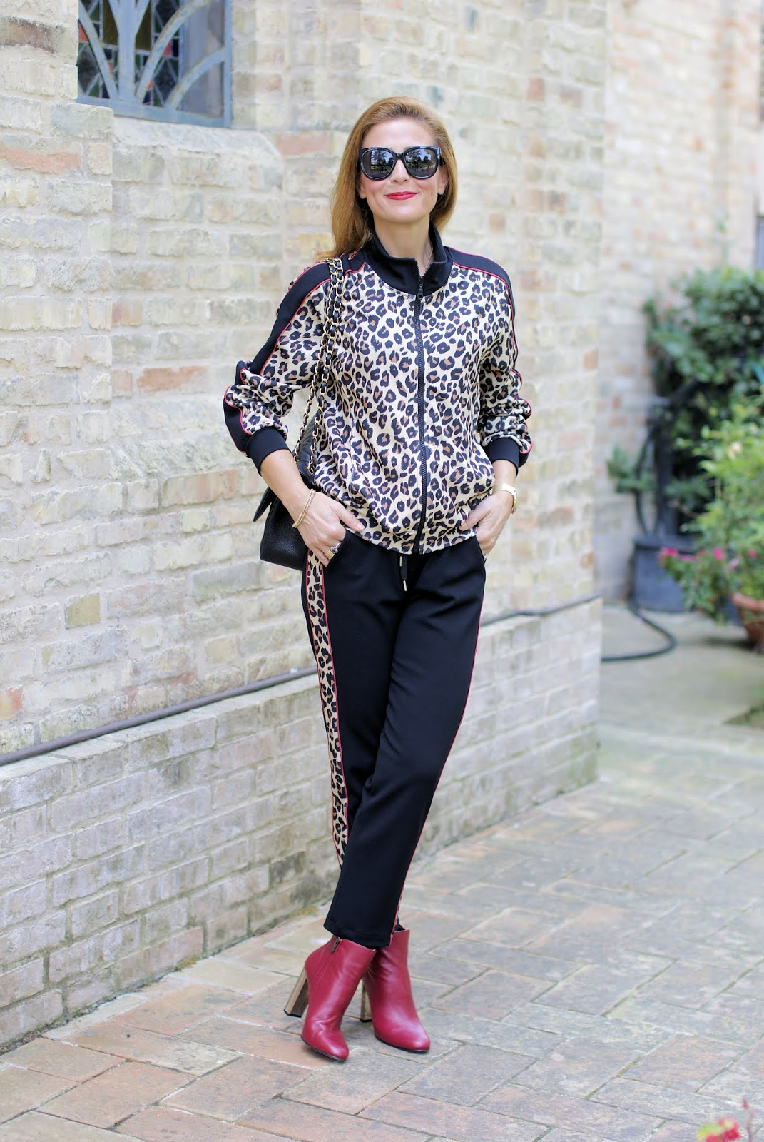 The animal print trend: leopard print tracksuit and Le Silla Rachel ankle boots on Fashion and Cookies fashion blog, fashion blogger style