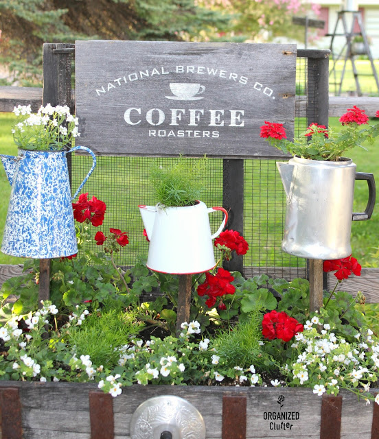 Coffee Pot Sign & Planters in a Junk Garden Vignette.