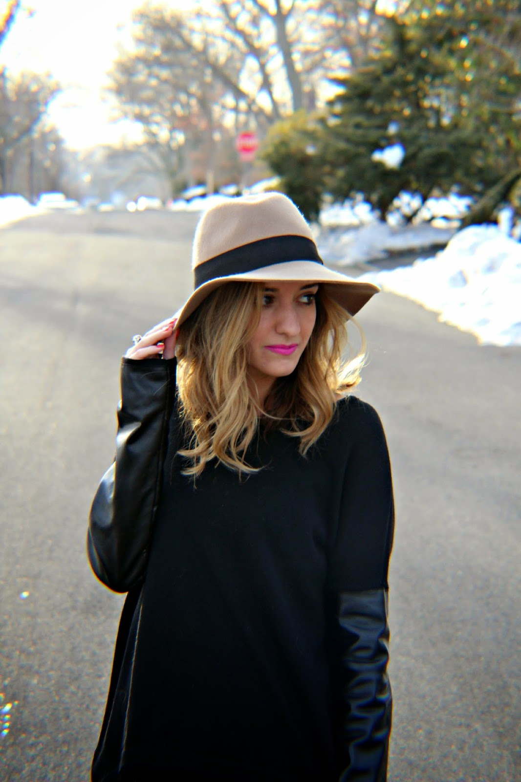black sweater with leather sleeves