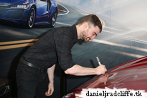 Updated: Daniel signs 2017 Acura NSX Hood for the Pediatric Brain Tumor Foundation