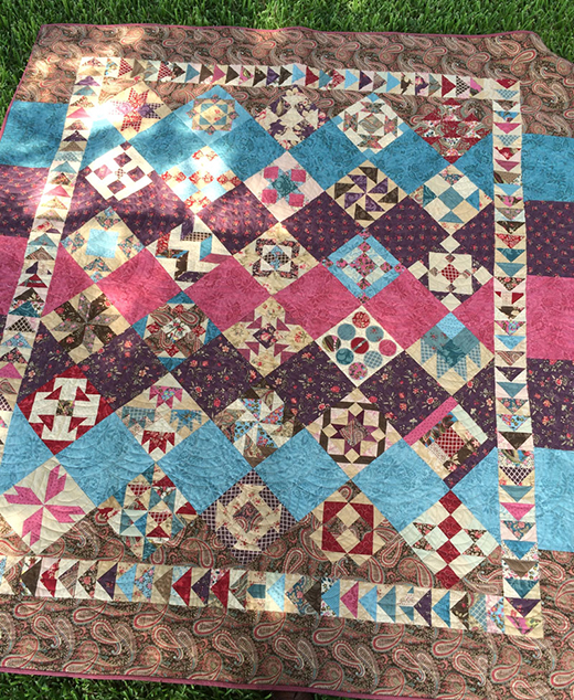 Moda Sampler Block Shuffle Quilt Free Pattern designed by Bear Creek Quilting Company