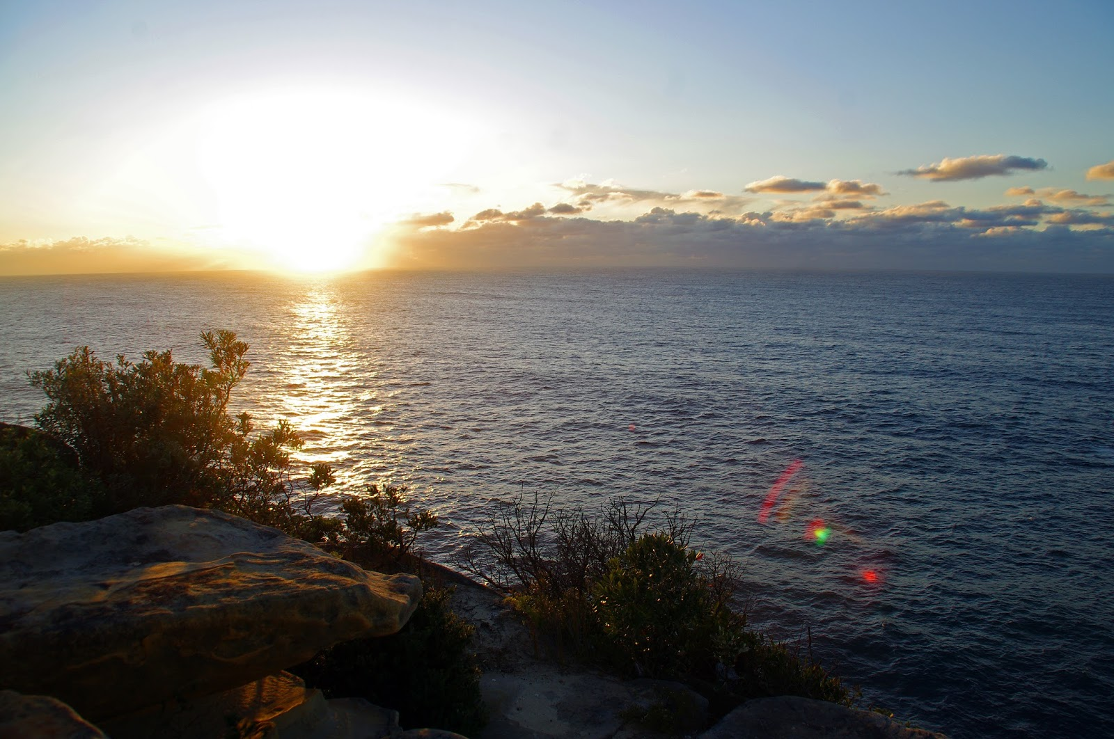 the sun over the sea from watsons bay sydney