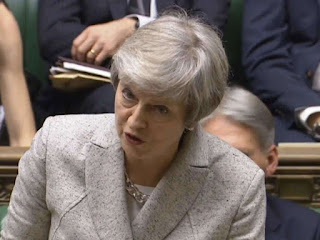 Theresa May defends draft Brexit deal agreed by EU, Britain