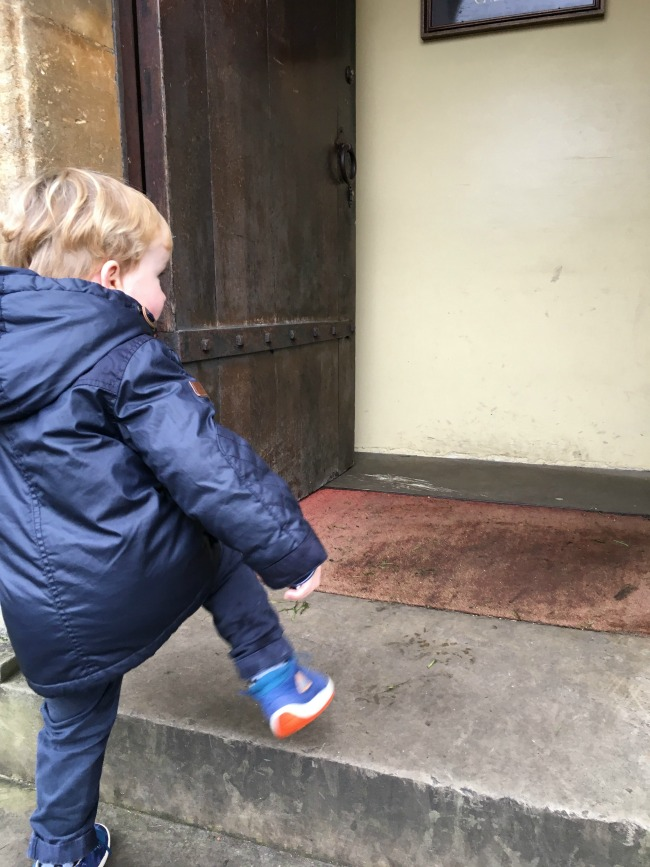 toddler-climbing-a-step-at-Cardiff-Castle