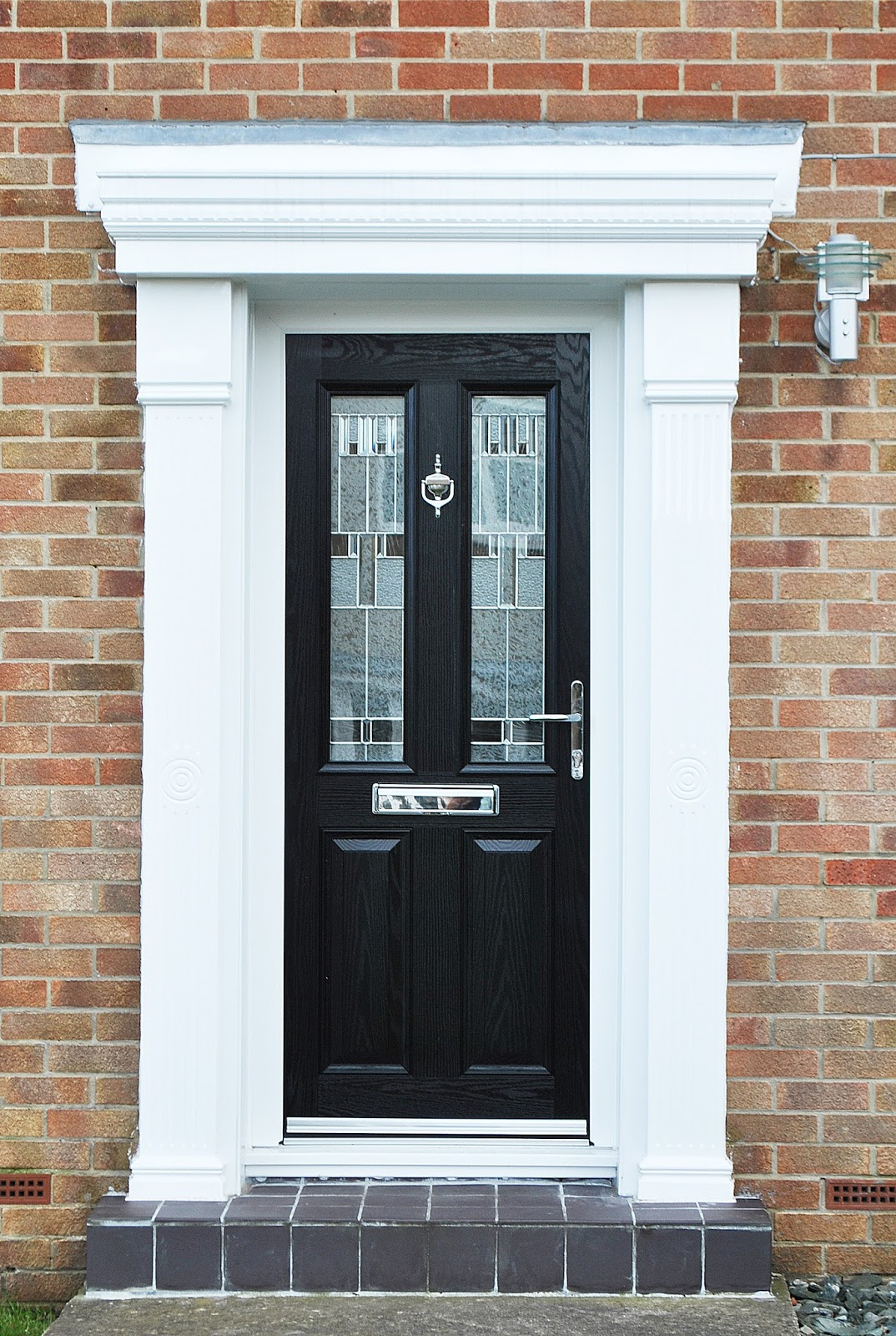 Our Beautiful Altmore Composite Door Design with Modern Zinc Prairie Glass finished off with Cambridge Canopy Surround & News Blog
