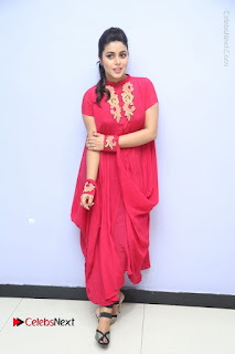 Actress Poorna Latest Stills in Red Dress at Rakshasi First Look Launch  0346.JPG
