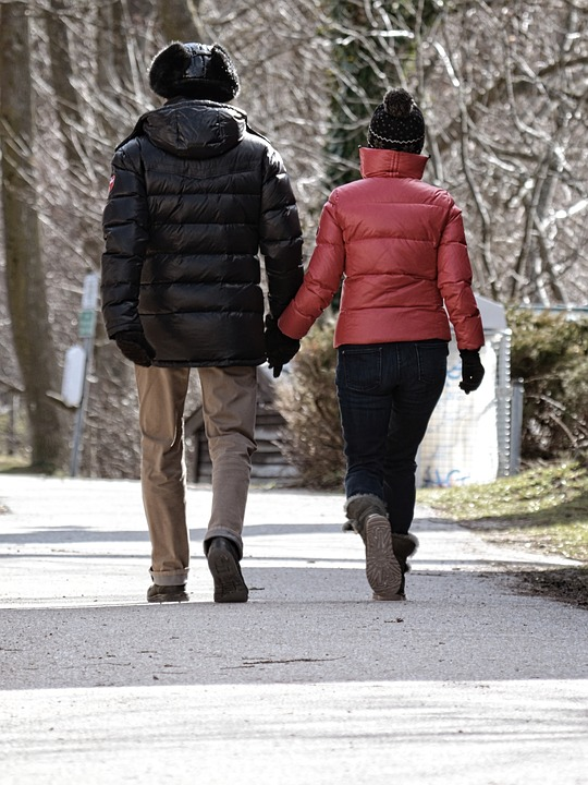 Couple with winter caps and prone to hair static