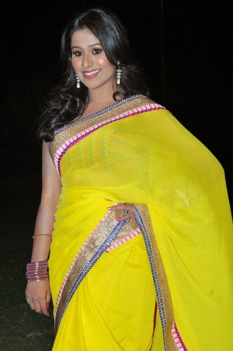 Manalee Hot Navel Show Photos In Yellow Saree