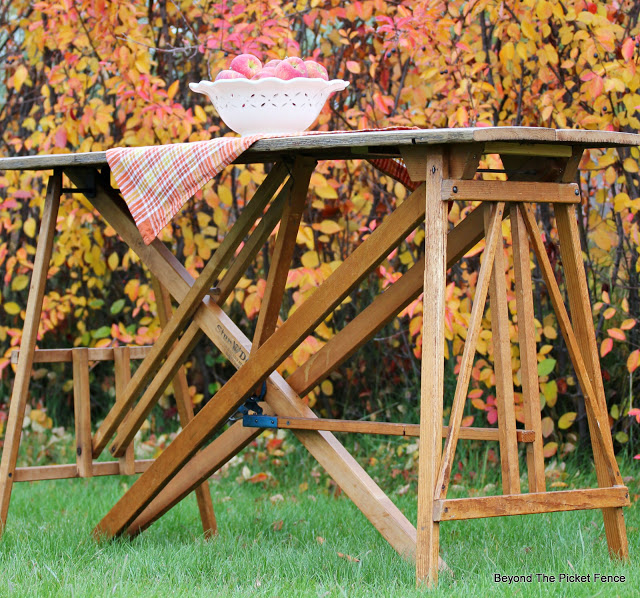 repurpose ironing board bases into a table