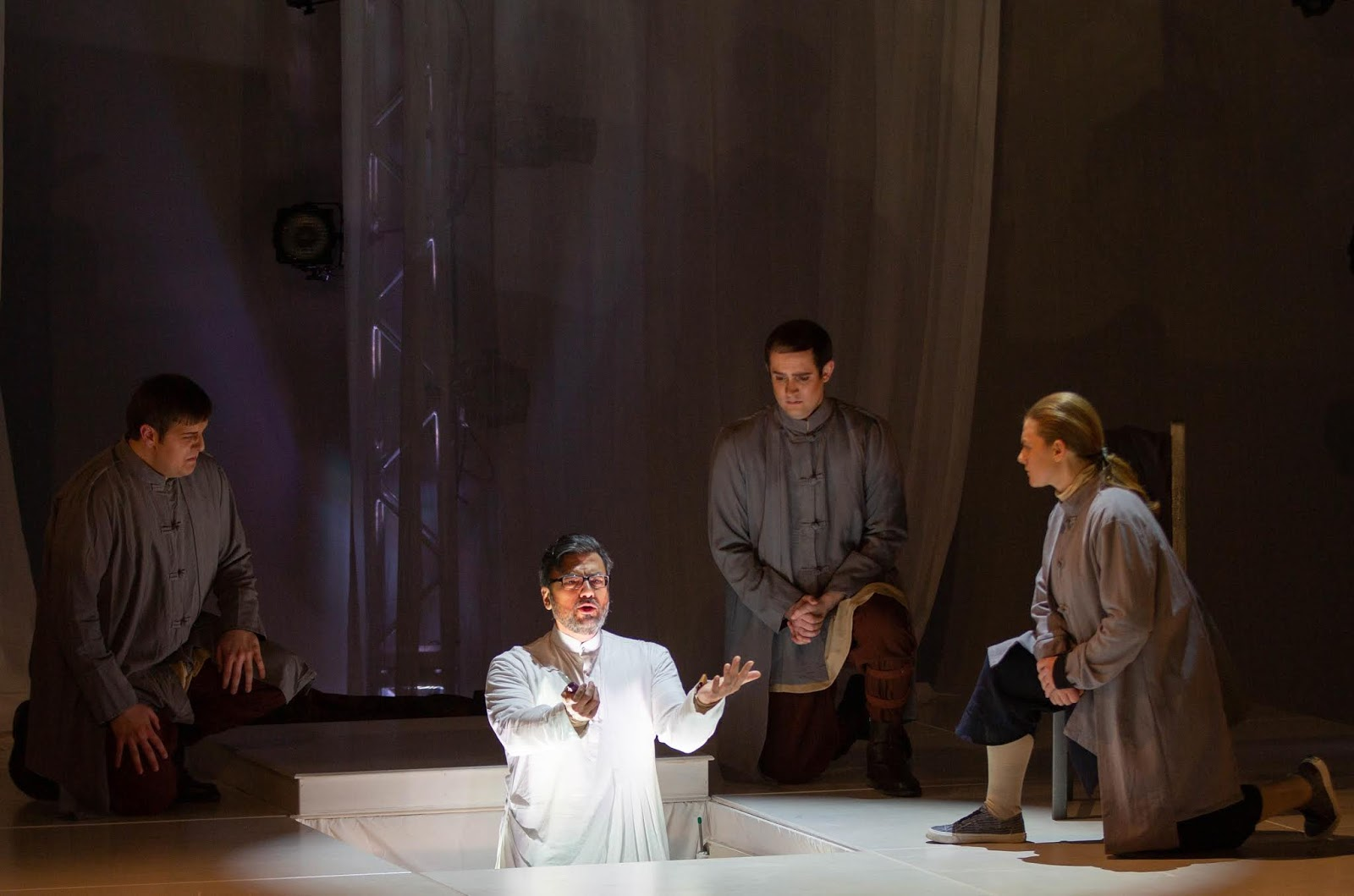 IN REVIEW: bass MATTHEW TREVIÑO as Seneca (center), with (from left to right) tenor NICHOLAS HUFF, baritone NATHANIEL HILL, and soprano NICOLE HEINEN as Seneca's followers, in Florentine Opera's March 2019 production of Claudio Monteverdi's L'INCORONAZIONE DI POPPEA [Photograph by Kathy Wittman, © by Ball Square Films]