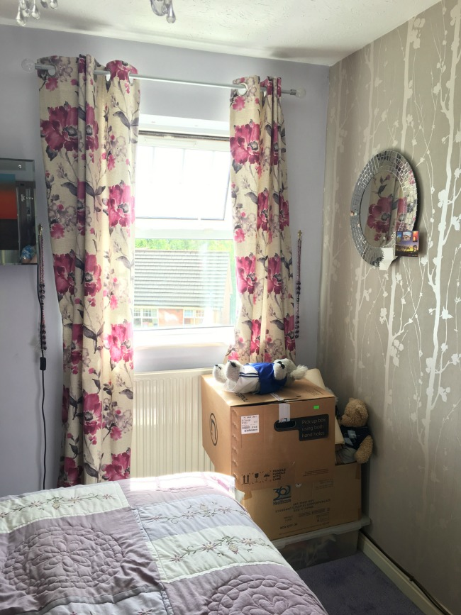 Bedroom-makeover-with-Valspar-Paint-before-image-of-bed-boxes-and-wallpapered-wall