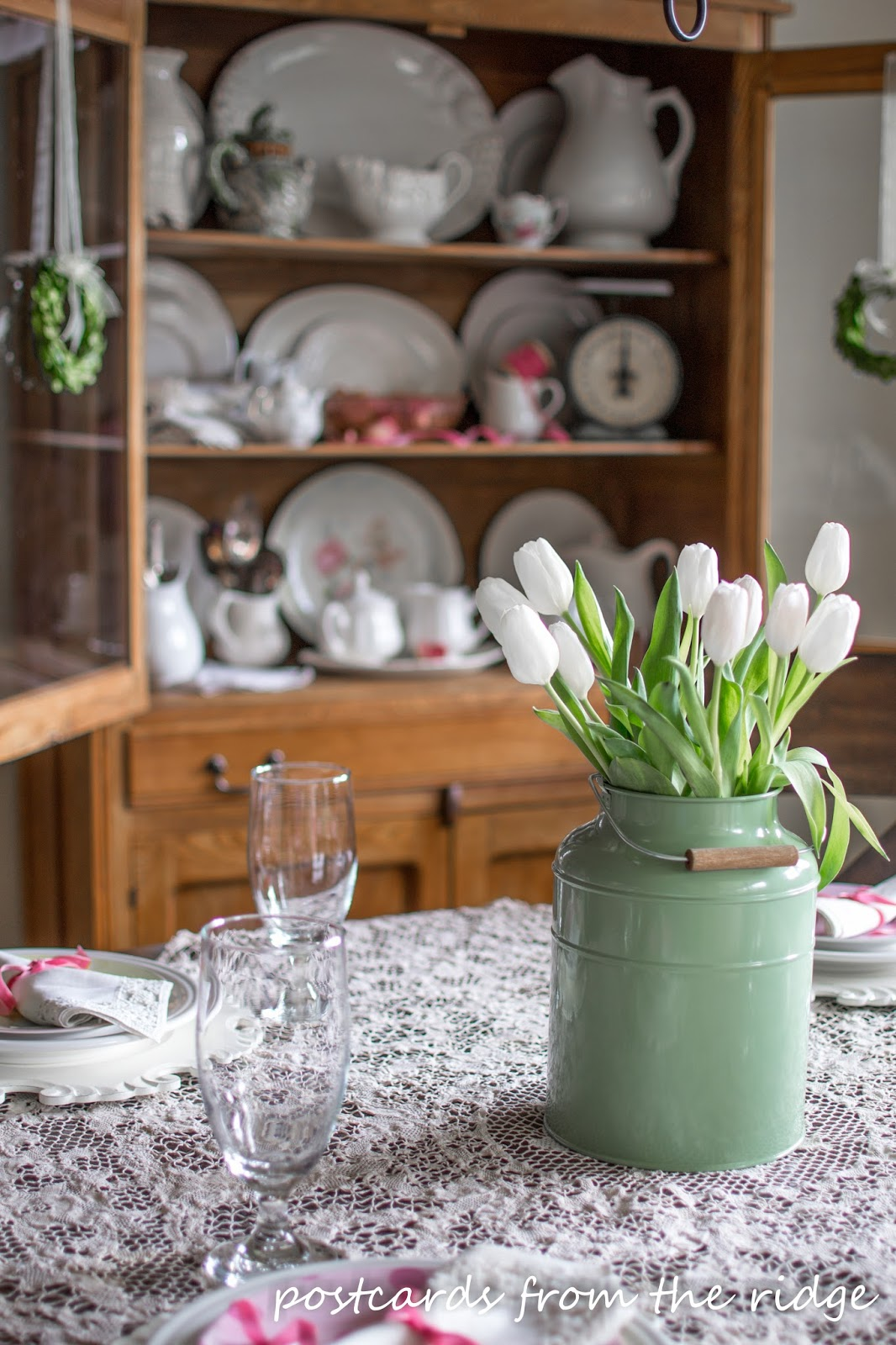 Using vintage finds and fresh white tulips for a spring table.