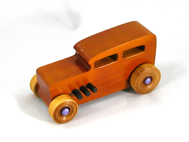 Left Front - Wooden Toy Car - Hot Rod Freaky Ford - 32 Sedan - Pine - Amber Shellac - Metallic Purple Hubs
