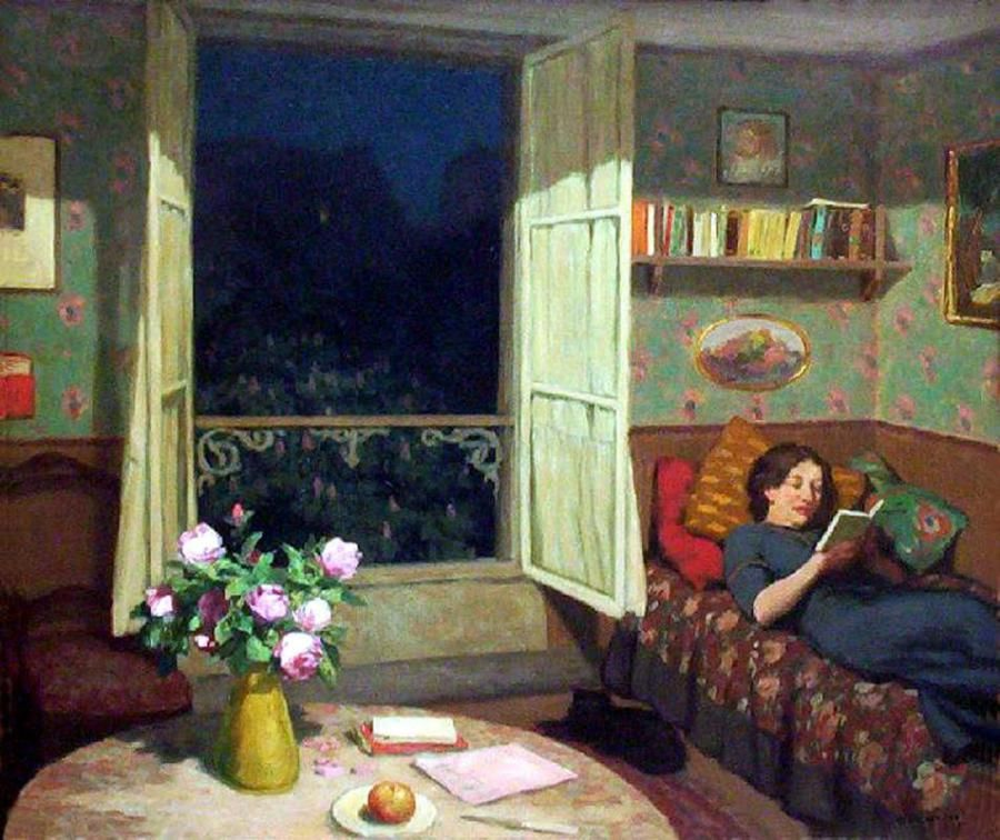 Vilma reading on a sofa