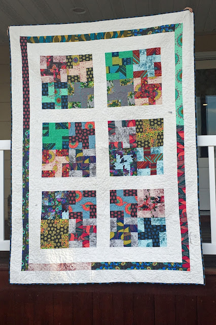 Quilt from Anna Maria Horner's Mod Corsage fabric line pattern from Strip Savvy Book