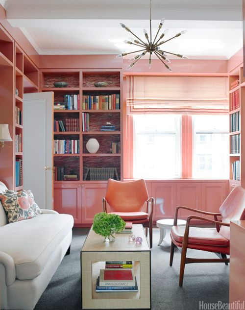 modern and feminine living room with pink walls