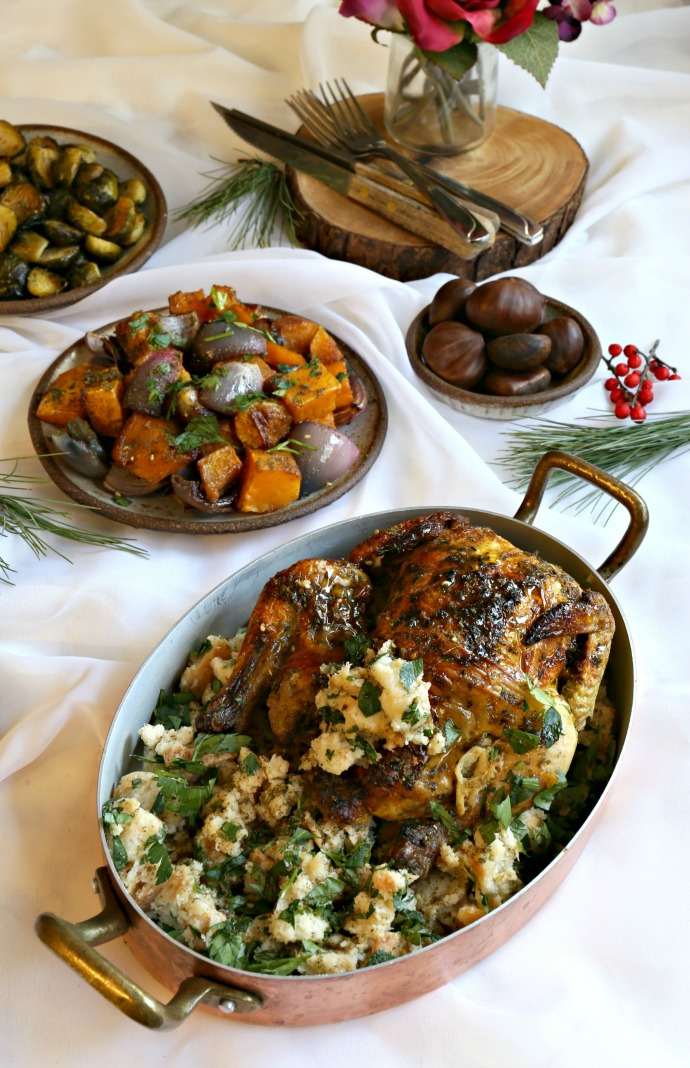 Roasted and stuffed Cornish game hen along with Middle Eastern spiced side dishes.