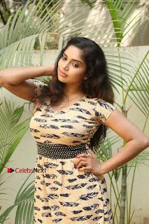 Telugu Actress Karunya Chowdary Stills in Short Dress at ATM Not Working Press Meet  0027.jpg