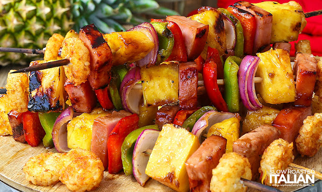 Grilled Hawaiian Ham Kabobs are the perfect portable breakfast or brinner. A simple recipe loaded with your favorite flavors: ham, pineapple and veggies skewered and brushed with a glorious sweet and tangy sauce. It is grilled until perfectly smoky and delicious. This one is so good you'll be going back for more! http://www.theslowroasteditalian.com/2017/06/grilled-hawaiian-ham-kabobs.html  Best Ever Orange Honey Glazed Ham recipe starts with a bone in ham and a glaze that will absolutely blow your mind. A few simple ingredients come together to create the most glorious ham you have ever tasted. It is sweet, tangy and utterly divine. http://www.theslowroasteditalian.com/2015/03/orange-honey-baked-ham-recipe.html  Cheesy Monte Cristo Bombs are loaded with ooey gooey cheese, ham and turkey. They are a portable version of your favorite Monte Cristo sandwich that is purely craveable!  http://www.theslowroasteditalian.com/2017/09/cheesy-monte-cristo-bombs.html