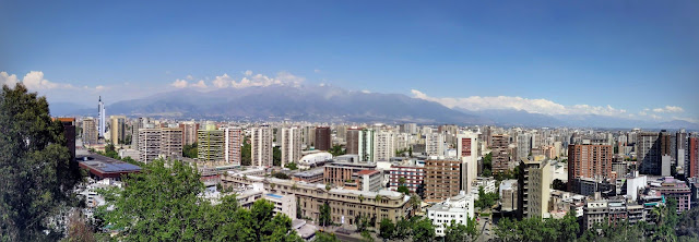 Why visit Santiago: Panoramic view of the Santiago skyline and mountains from Santa Lucia Hill
