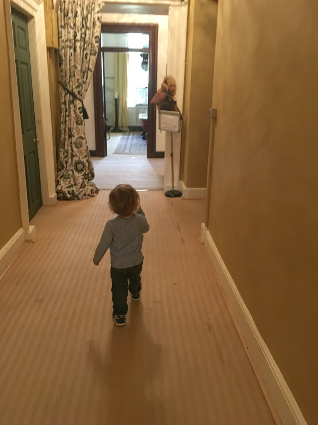toddler-walking-down-corridor