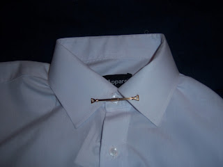 Wearing a collar clip without a tie.