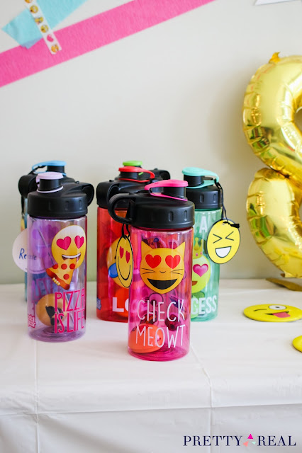 water bottles as party favors at an emoji birthday party