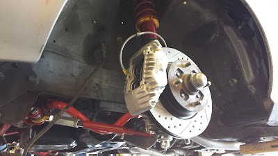 Installed Mini Cooper S Drilled Slotted Rotors and Mazda RX-7 FC Brake Calipers