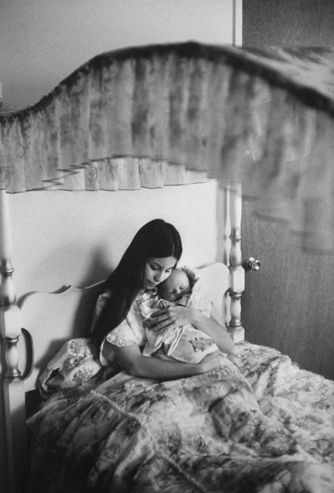 "In the canopied bed where she had slept since childhood, Judy cuddled her son Dylan. ""My son may have been unplanned,"" Judy said, ""but he is not unloved."""