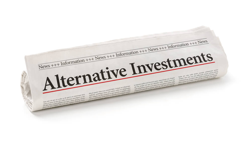 alternative investment written on a folded newspaper