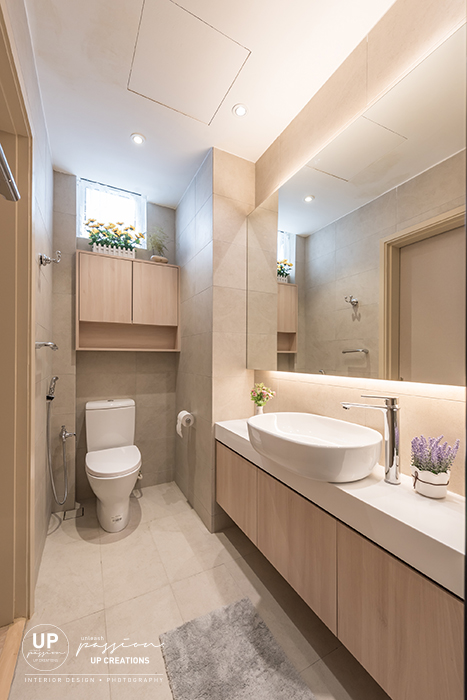 royal regent condo bathroom with wood texture cabinet above water closet for storage