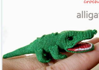 http://translate.google.es/translate?hl=es&sl=en&tl=es&u=http%3A%2F%2Fwww.craftfoxes.com%2Fhow_tos%2Fitty-bitty-crocheted-aligator