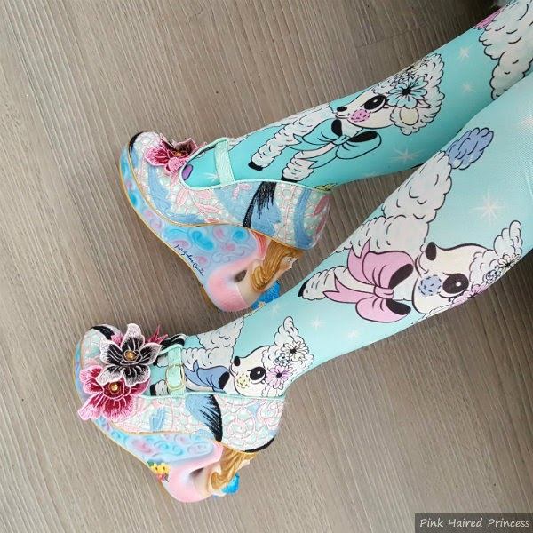 legs wearing lamb printed tights and mermaid heeled shoes