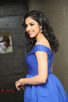 Actress Ritu Varma Pos in Blue Short Dress at Keshava Telugu Movie Audio Launch .COM 0057.jpg