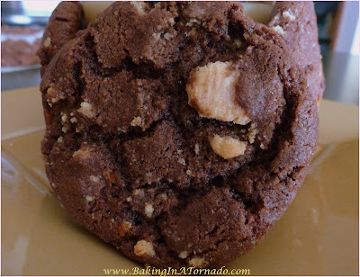 Treat Filled Cookies, a rich chocolate cookie with a few surprise treats baked in | Recipe developed by www.BakingInATornado.com | #recipe #cookies #chocolate