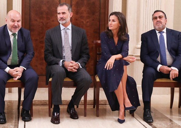 Queen Letizia wore a new asymmetric midi dress by Maje. We saw the same dress on Argentina's First Lady Juliana Awada