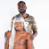 Man poses with his topless wife and breast cancer survivor