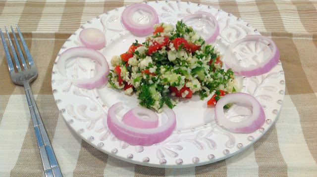 Tabbouleh Salad on Plate with red onions