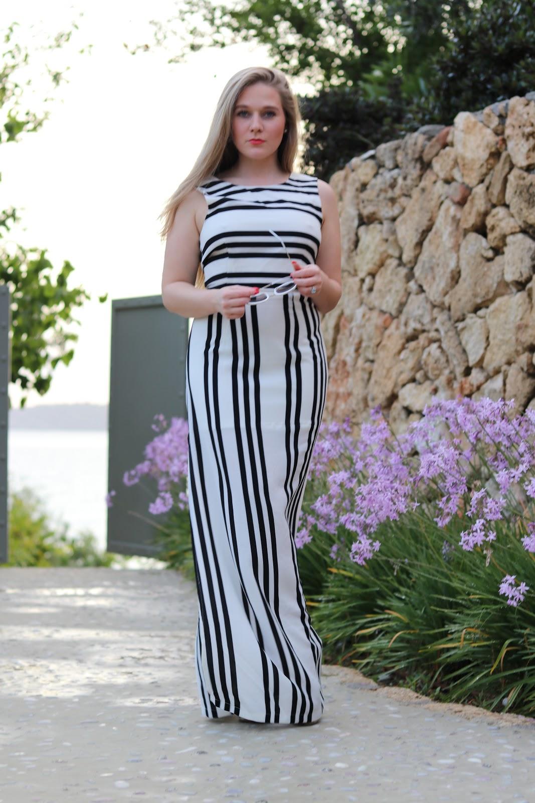 Blonde girl in stripe maxi dress from ASOS at F Zeen Resort, Kefalonia
