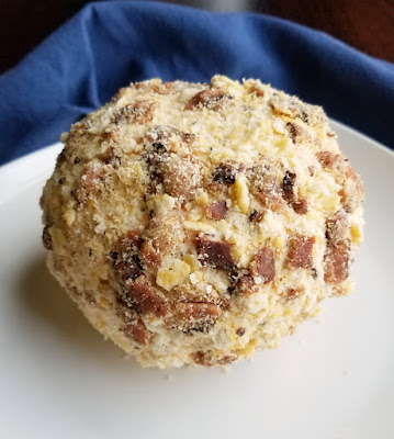cheese ball coated in bacon and cracker crumbs