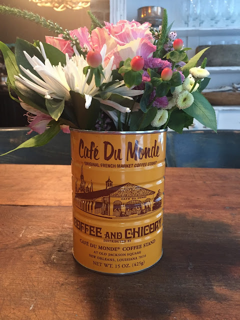 New Orleans themed wedding shower with cafe du monde coffee cans