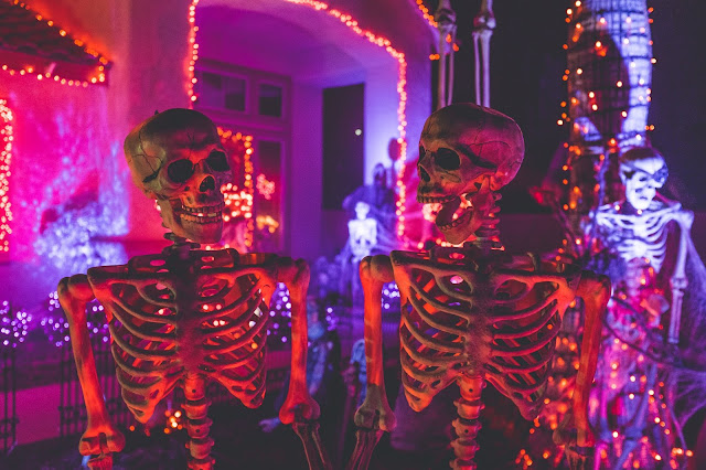 A house dressed up for Halloween with lights and skeletons