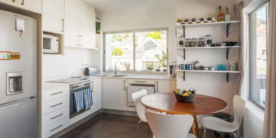 kitchen, white, round table, modern, neat, betty bake, review, interior, cape town, cupboards, white chairs,