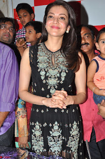 Kajal Aggarwal in lovely Black Sleeveless Anarlaki Dress in Hyderabad at Launch of Bahar Cafe at Madinaguda 005.JPG