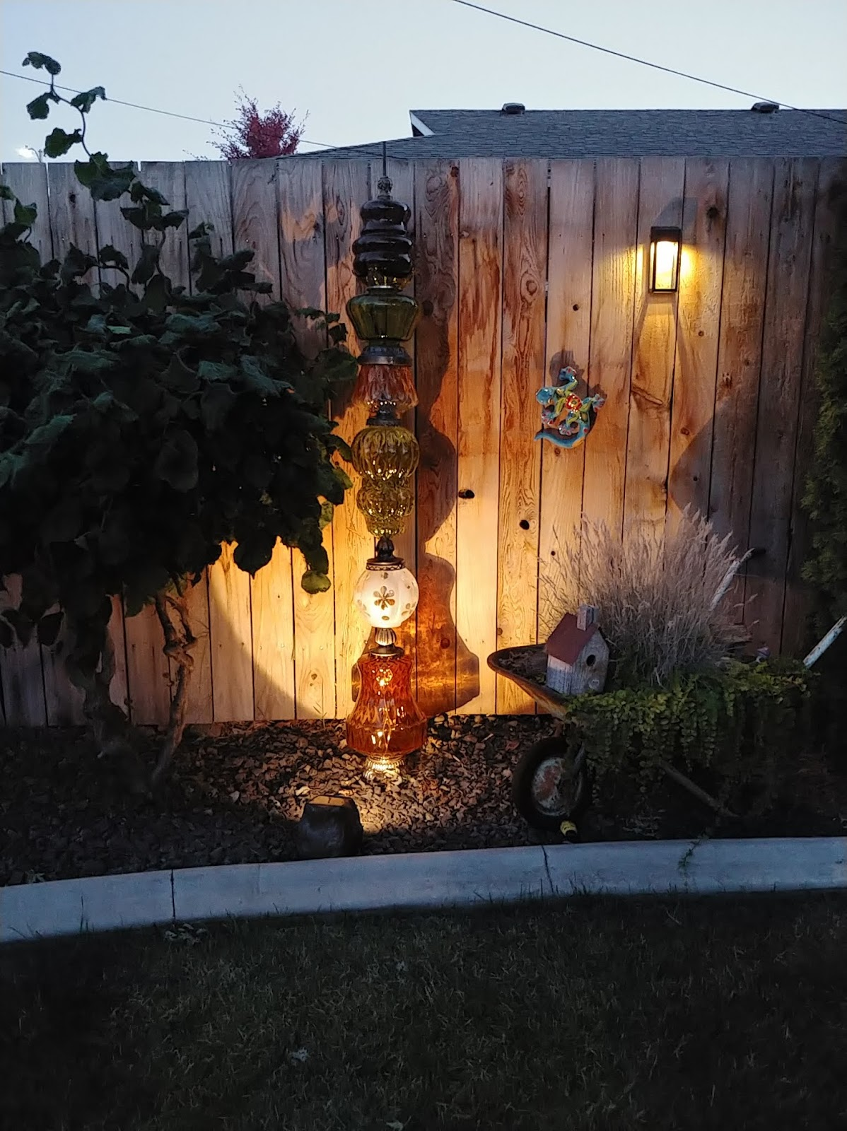 rock solar light to highlight a garden accent