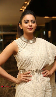 Actress Rakul Preet Singh Stills in White Dress at Winner Pre Release Function  0007.jpg
