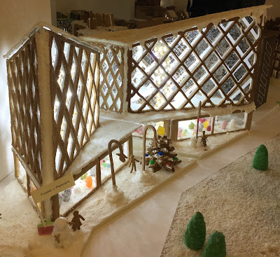 Pic of angled gingerbread offices with diamond shaped boiled sweet glass windows