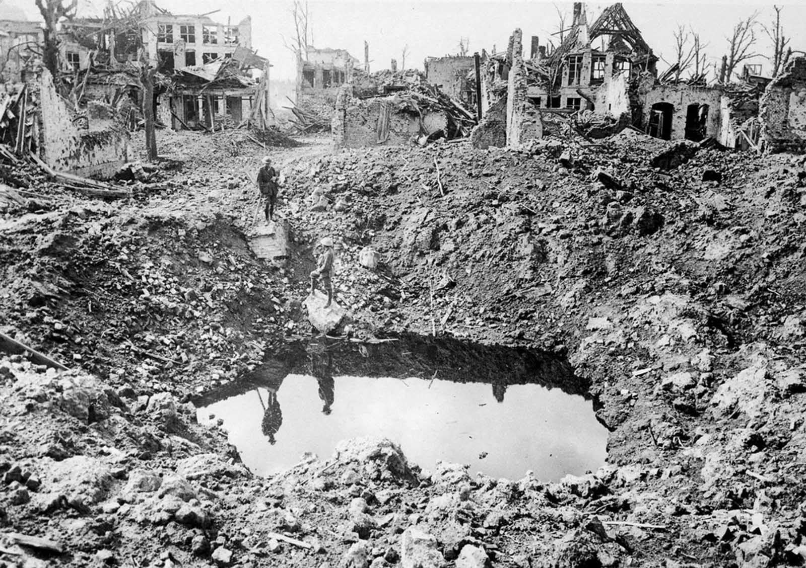 A gigantic shell crater, 75 yards in circumference, Ypres, Belgium, October 1917.