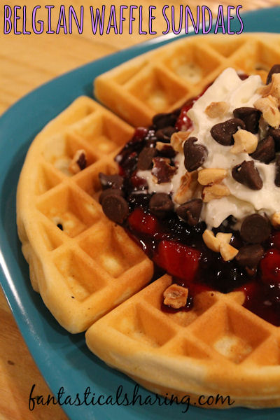 Belgian Waffle Sundaes | Fluffy waffles topped with a mixed berry sauce, whipped cream, chocolate, and macadamia nuts! #breakfast #recipe #waffles